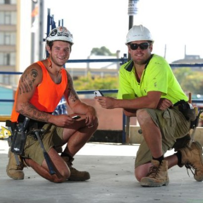 Safe Worksites across Geelong.  Tradies use their mobile phones to win prizes related to safety.  Orange Singlet:  Mitch White and Yellow singlet:  Kyle Edlich
